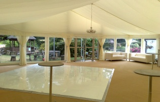 Clearspan Marquees - inside, dancefloor and bar tables